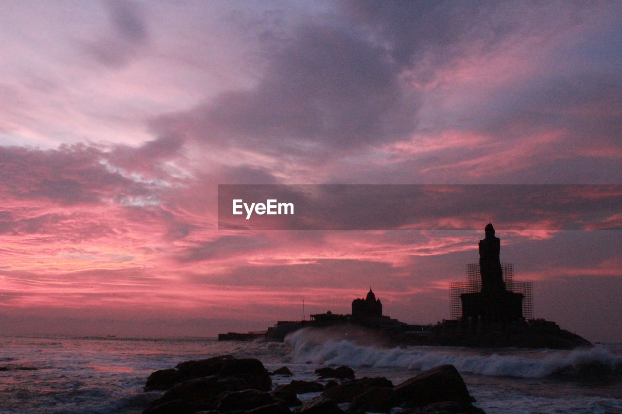 sunset, sky, architecture, cloud - sky, water, building exterior, built structure, sea, nature, beauty in nature, outdoors, scenics, no people, lighthouse, horizon over water, day