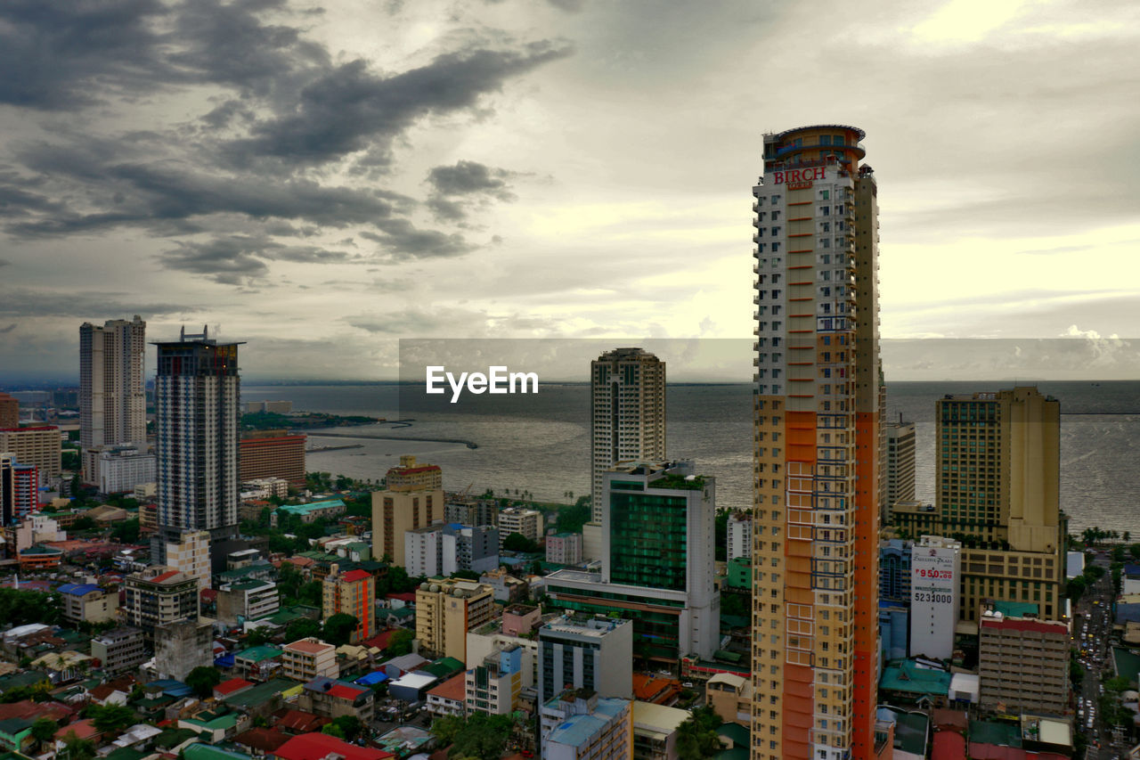 architecture, cloud - sky, sky, building exterior, built structure, skyscraper, city, outdoors, no people, sunset, modern, day, cityscape, water