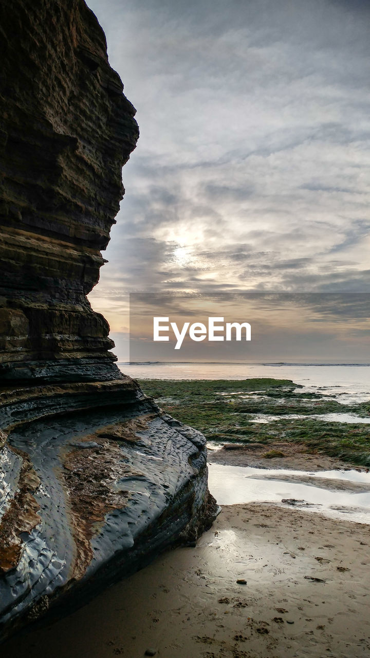 sea, water, sky, land, beach, rock, beauty in nature, cloud - sky, sunset, scenics - nature, rock - object, solid, tranquil scene, nature, tranquility, no people, horizon over water, rock formation, wave, outdoors, stack rock, eroded