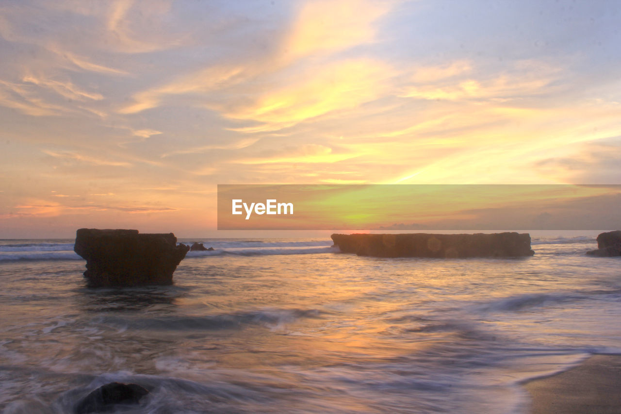 sunset, sea, sky, water, scenics - nature, cloud - sky, beauty in nature, motion, horizon over water, beach, orange color, wave, land, nature, horizon, no people, rock, tranquil scene, tranquility, outdoors