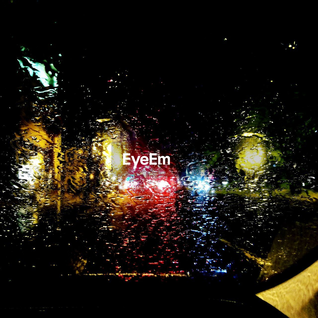 night, illuminated, wet, no people, water, rain, drop, transparent, glass - material, transportation, vehicle interior, multi colored, car, mode of transportation, nature, rainy season, window, windshield, glowing, outdoors, raindrop, light, glass