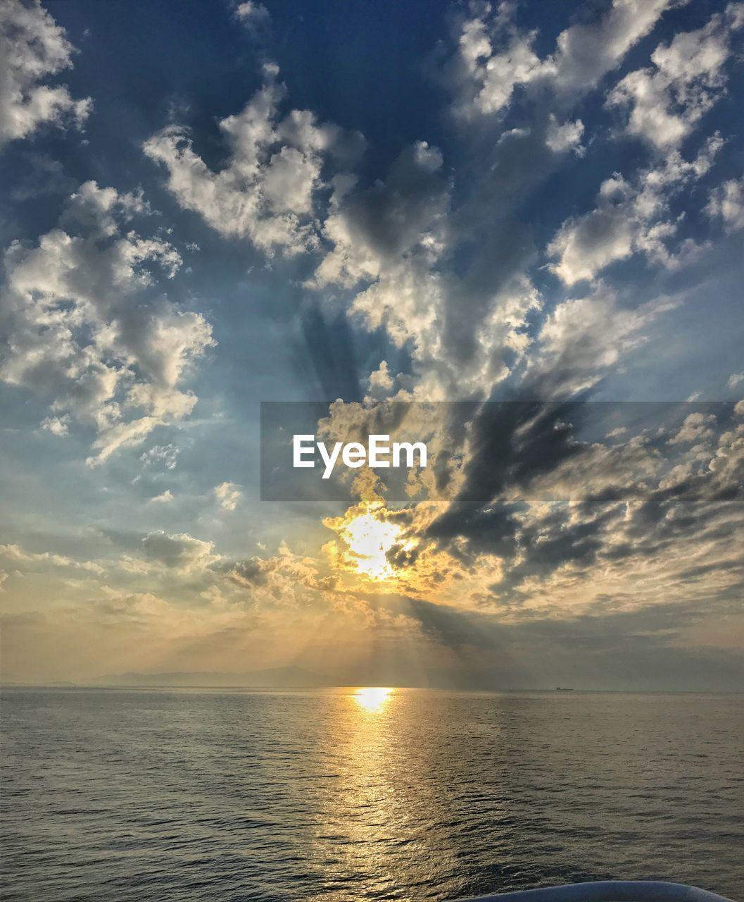 sky, cloud - sky, water, horizon, sea, horizon over water, beauty in nature, sunset, scenics - nature, tranquility, tranquil scene, waterfront, nature, sunlight, idyllic, sun, seascape, no people, sunbeam, outdoors, bright