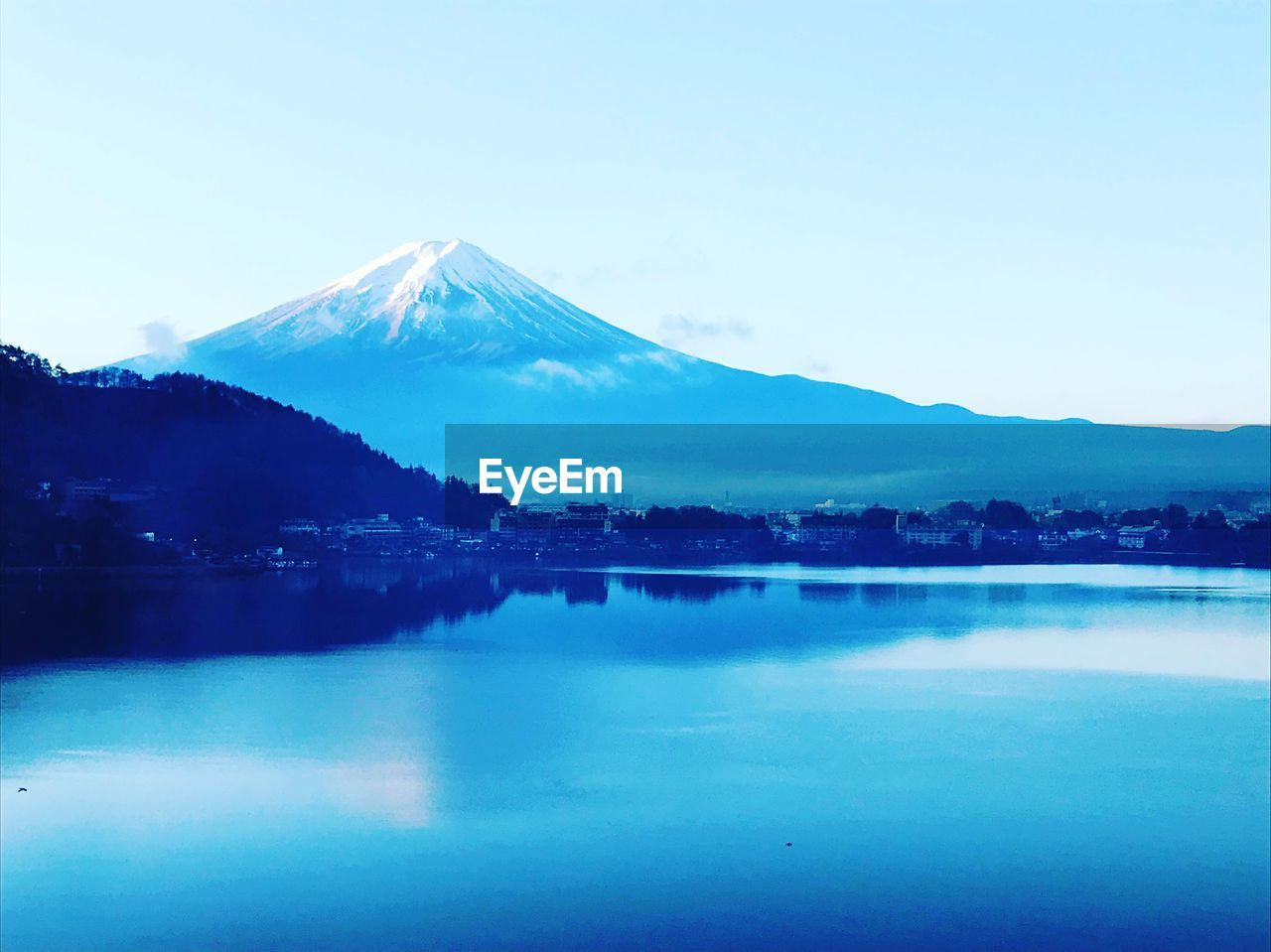 mountain, sky, scenics - nature, beauty in nature, water, tranquil scene, tranquility, lake, waterfront, reflection, blue, non-urban scene, volcano, nature, clear sky, no people, idyllic, winter, snowcapped mountain, mountain peak, outdoors