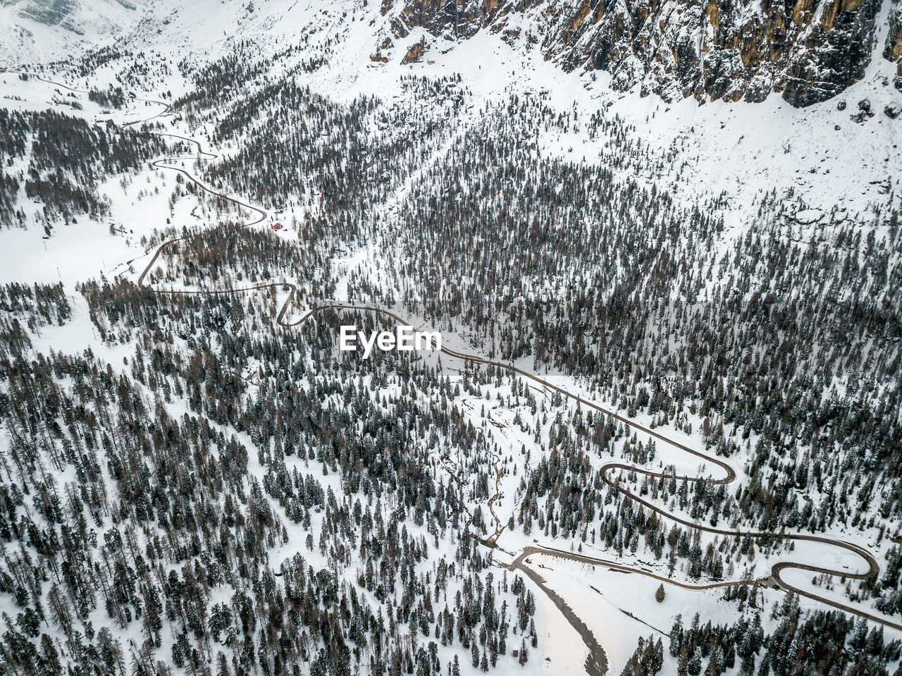 snow, cold temperature, winter, tree, plant, nature, beauty in nature, day, transportation, no people, scenics - nature, covering, mountain, white color, non-urban scene, snowing, high angle view, mode of transportation, outdoors, snowcapped mountain