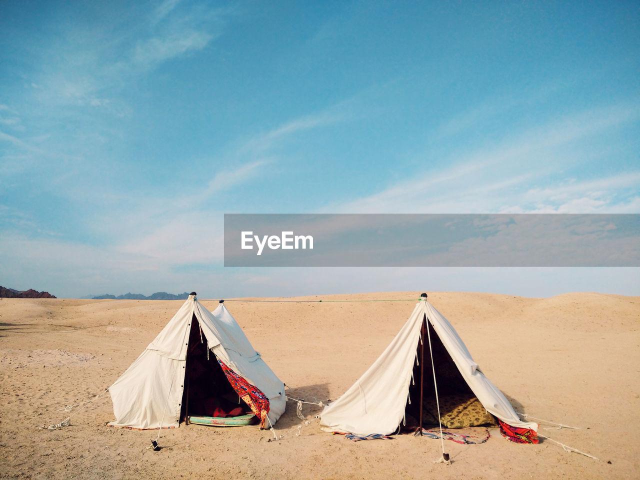 Tents At Desert Against Blue Sky