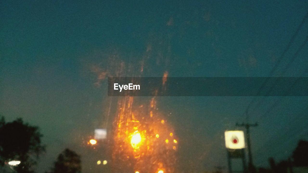 ILLUMINATED CITY IN SKY AT NIGHT