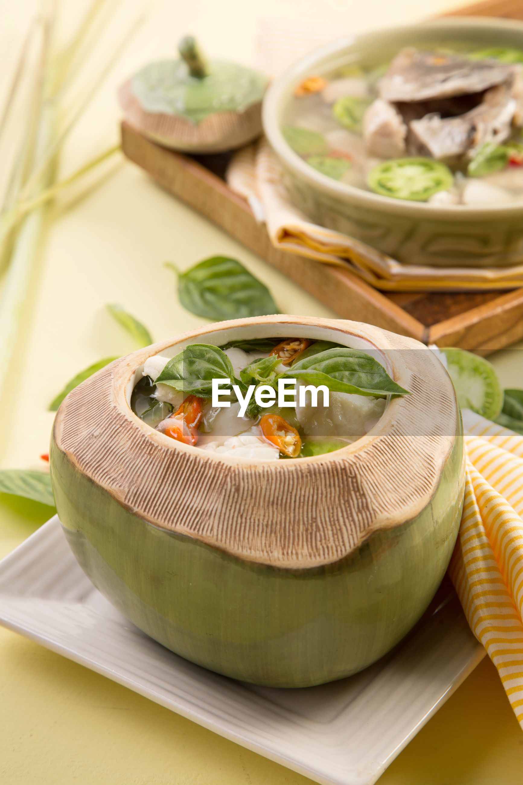 Fish soup served in coconut shell