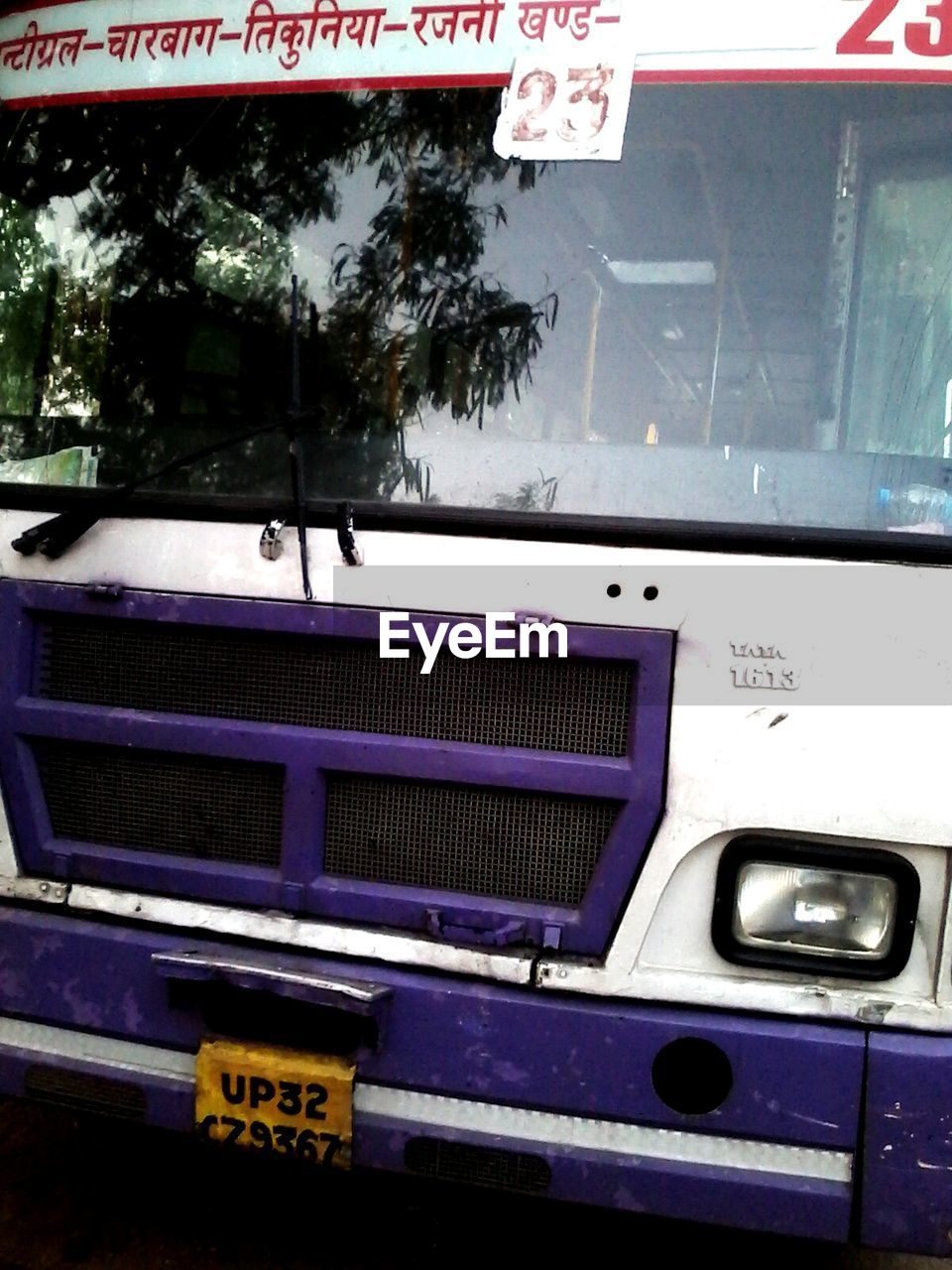 transportation, land vehicle, text, mode of transport, communication, car, no people, outdoors, day, close-up, tree