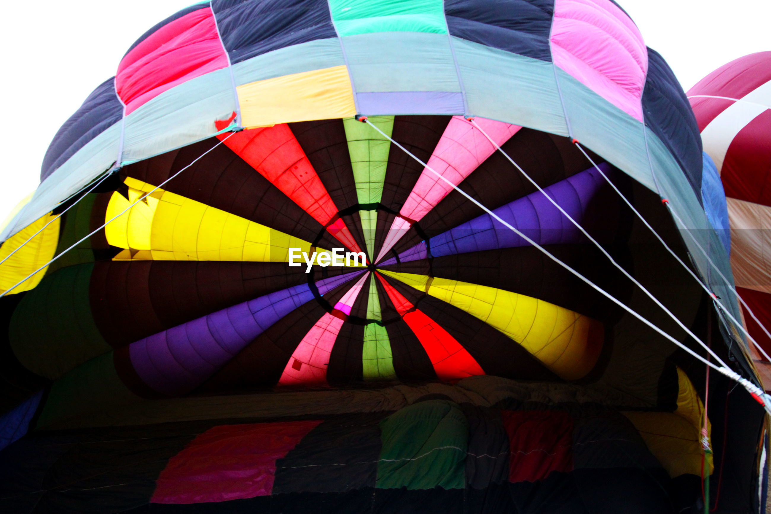 LOW ANGLE VIEW OF MULTI COLORED HOT AIR BALLOON