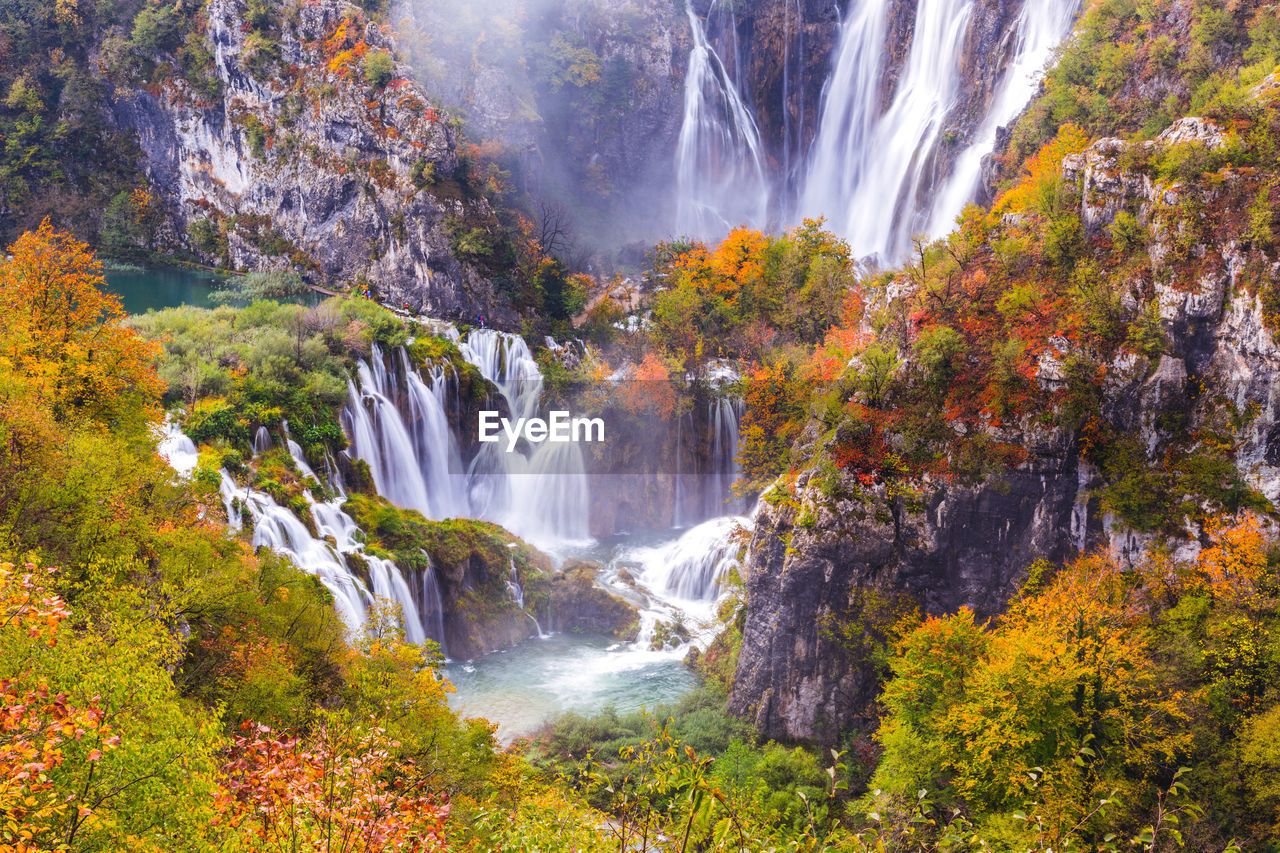 SCENIC VIEW OF WATERFALL DURING AUTUMN