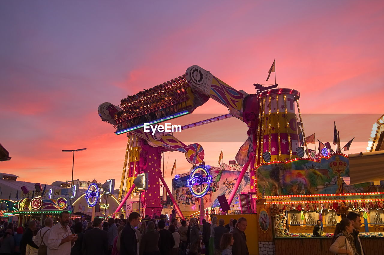 large group of people, real people, crowd, leisure activity, built structure, men, fun, sky, arts culture and entertainment, enjoyment, lifestyles, women, architecture, sunset, outdoors, building exterior, celebration, performance, togetherness, multi colored, day, city, people