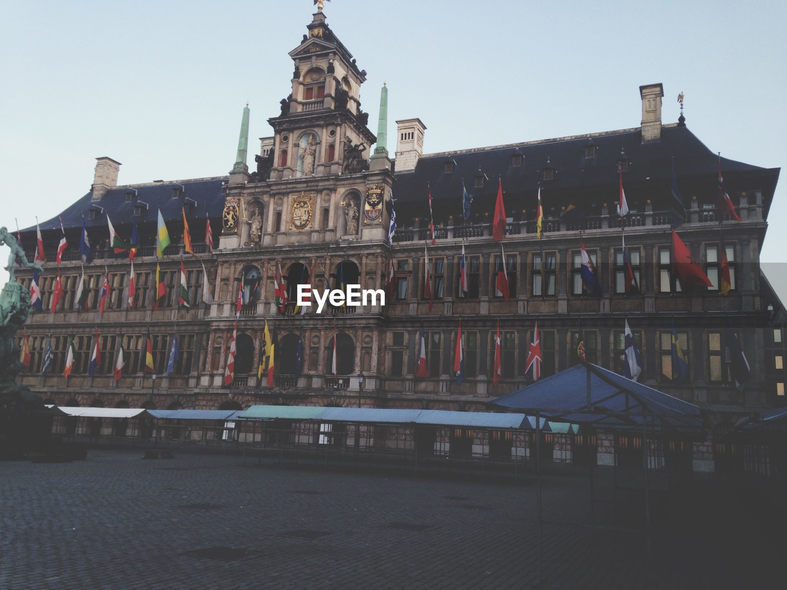 Low angle view of antwerp city hall against clear sky