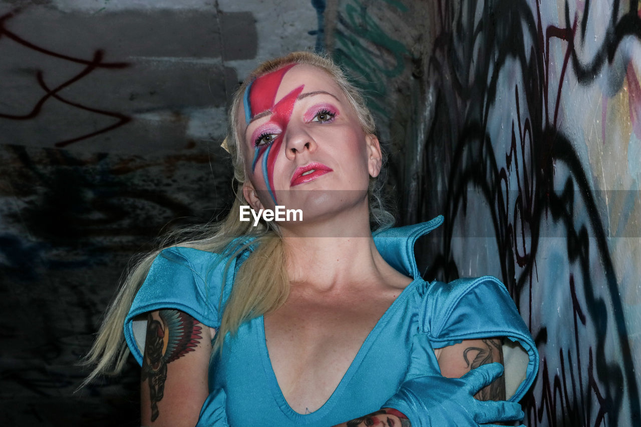 Portrait Of Female Model With Face Paint In Tunnel