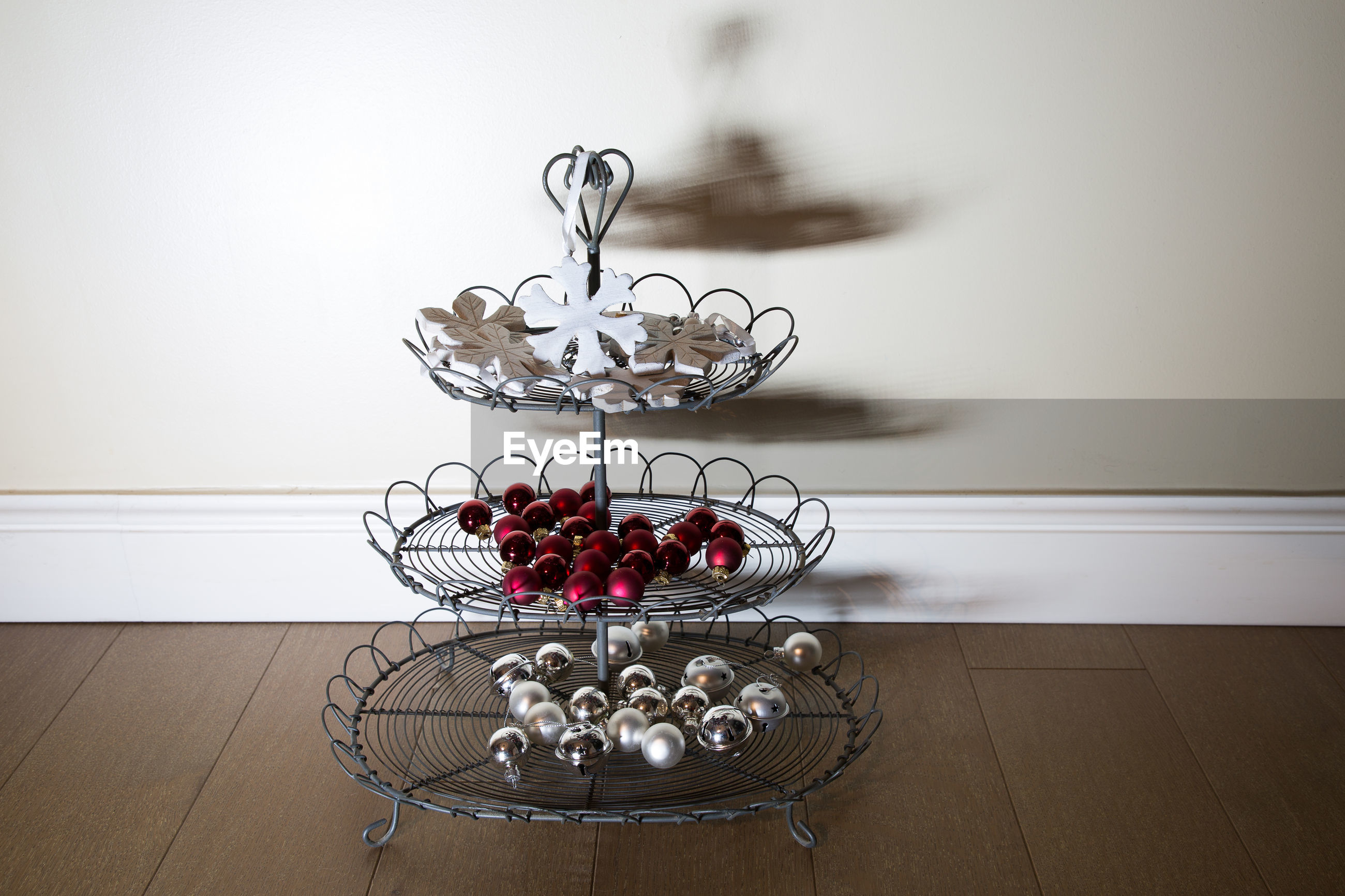 Christmas decorations on rack at table