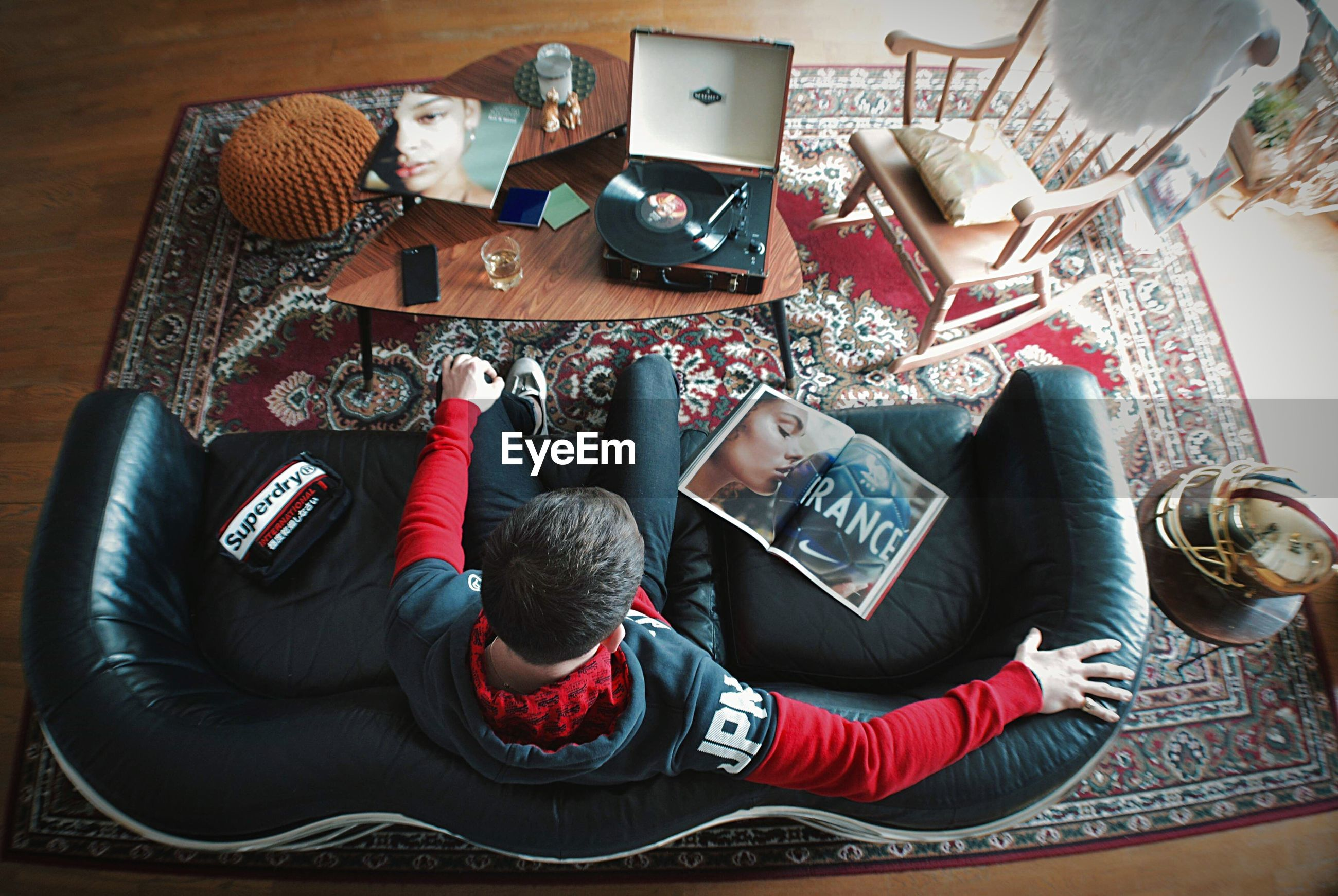 HIGH ANGLE VIEW OF MEN SITTING ON LAPTOP