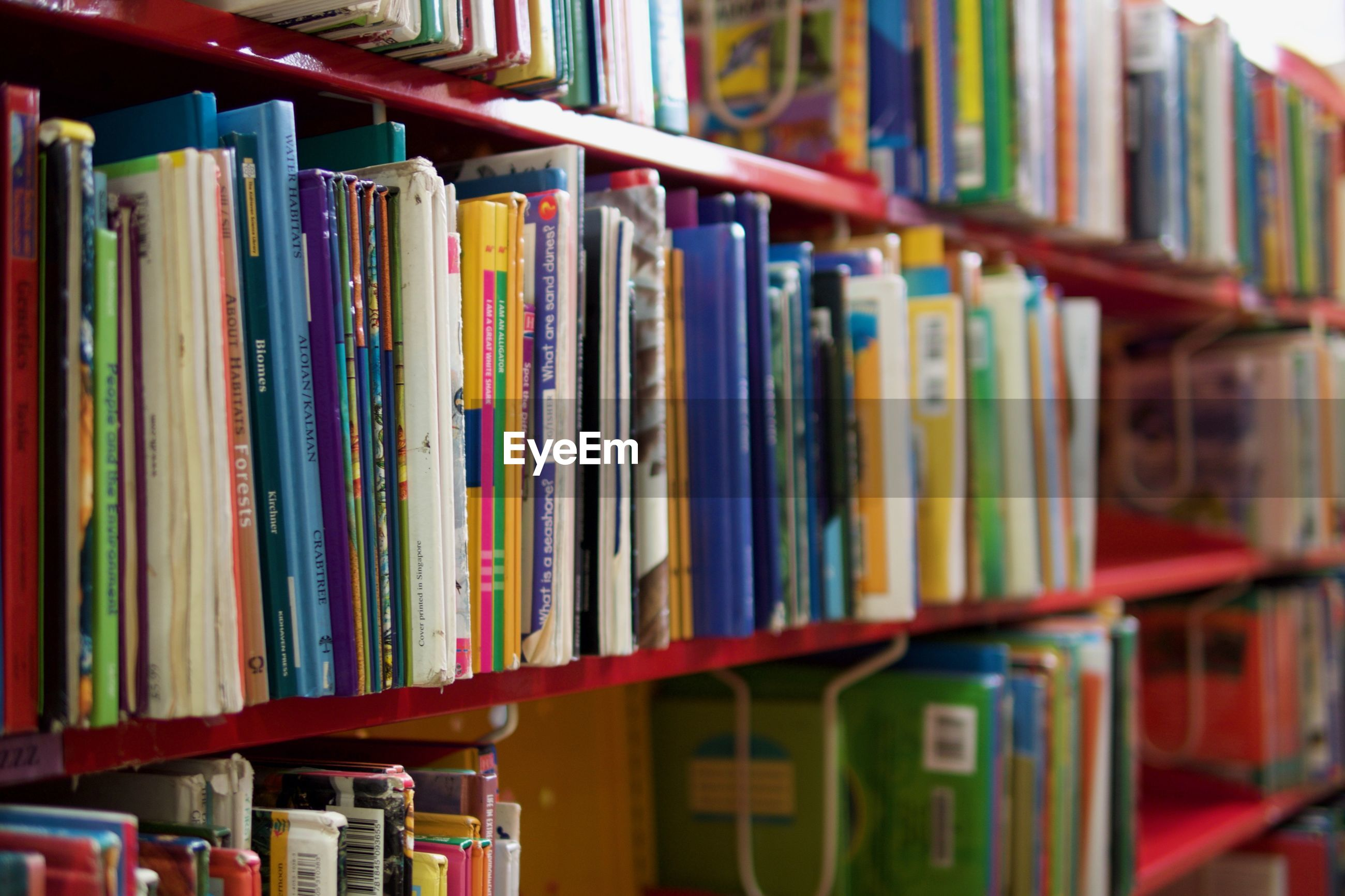 CLOSE-UP OF BOOKS IN SHELF AT LIBRARY