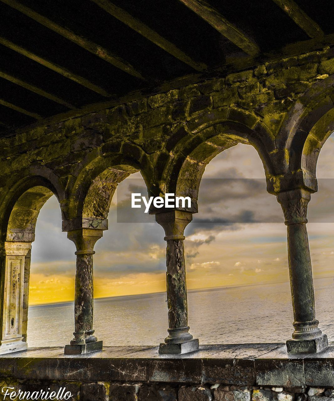 architecture, built structure, architectural column, arch, sky, water, history, sea, low angle view, no people, horizon over water, travel destinations, cloud - sky, outdoors, day, nature, building exterior