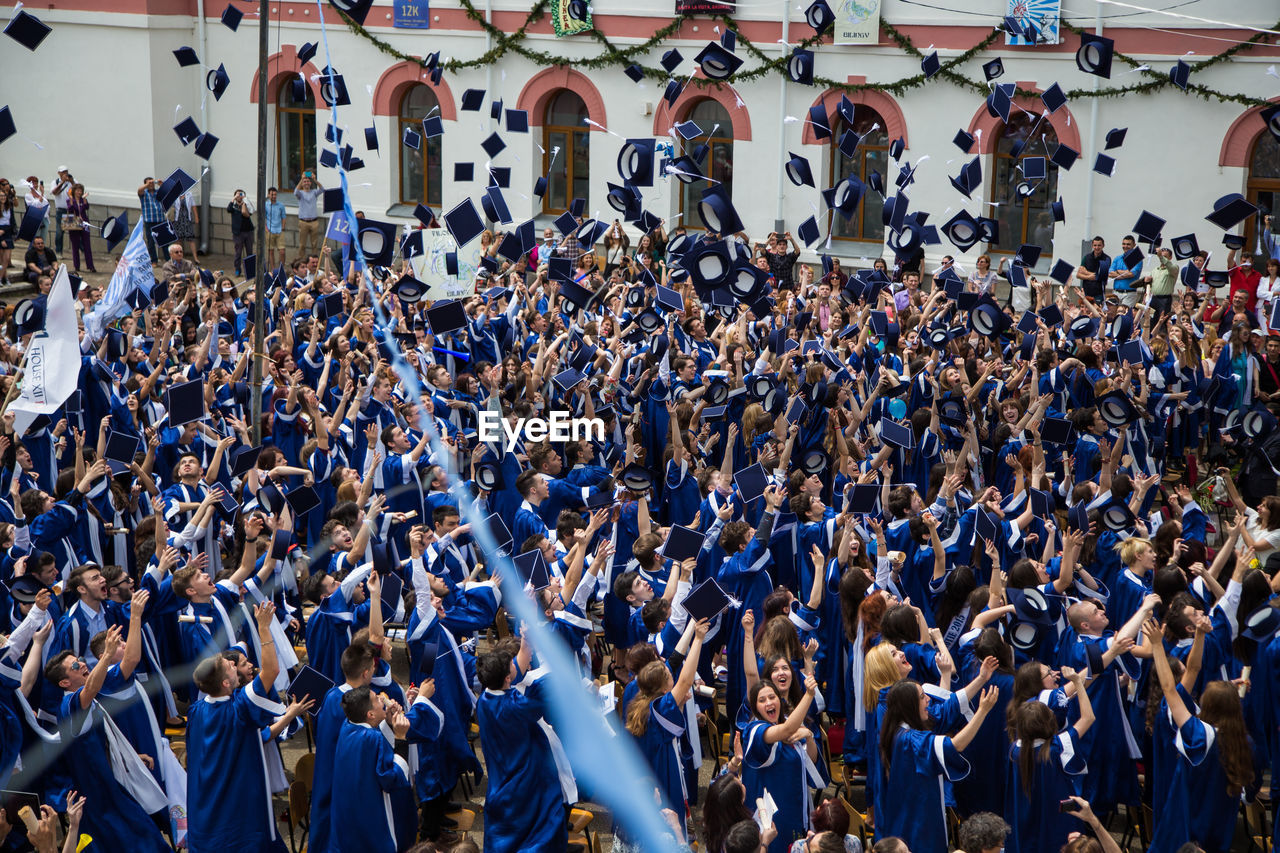 Students Throwing Caps At Graduation