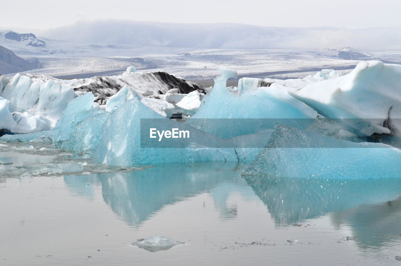 Icebergs Floating On Sea During Winter