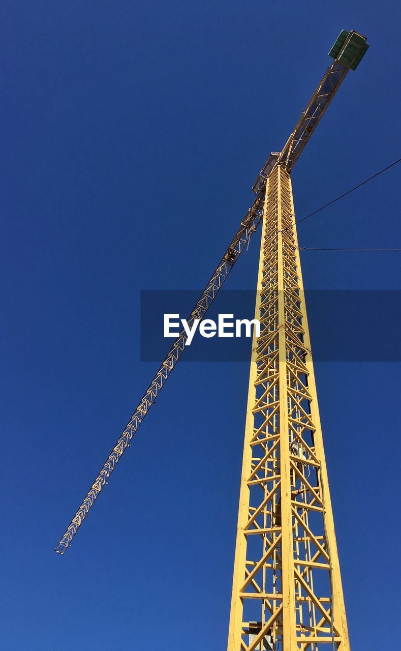 blue, low angle view, architecture, no people, clear sky, day, built structure, outdoors, progress, girder, sky