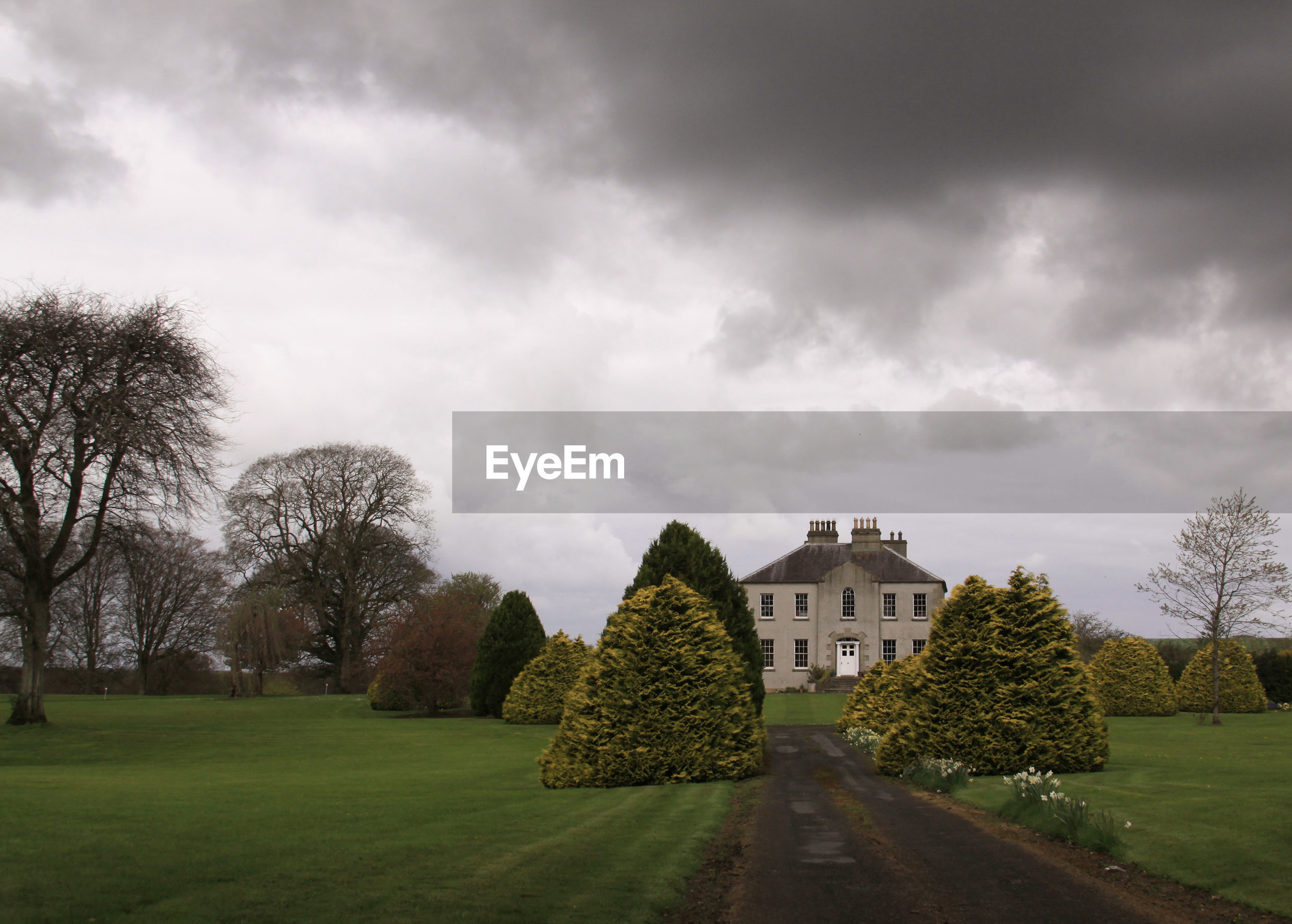 Haunted castle or house in ireland with dark clouds