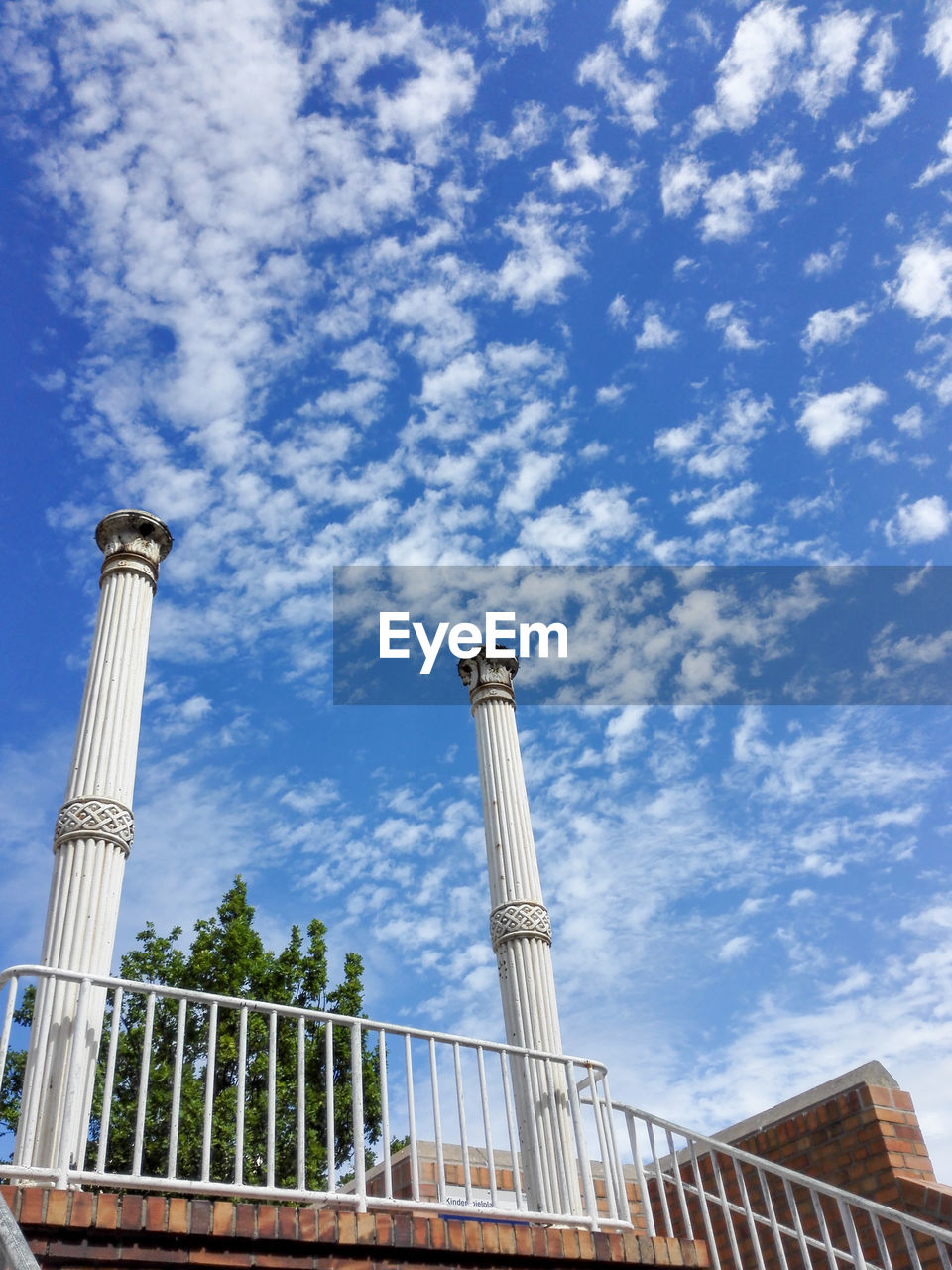 sky, built structure, low angle view, cloud - sky, architecture, building exterior, day, no people, nature, outdoors, building, travel destinations, blue, tourism, tall - high, travel, tower, history, architectural column, the past, pollution, height