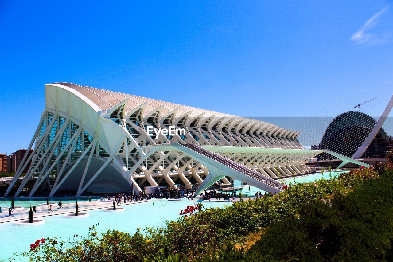 sky, architecture, built structure, blue, building exterior, nature, clear sky, day, copy space, modern, city, travel destinations, building, outdoors, no people, plant, travel, low angle view, tree
