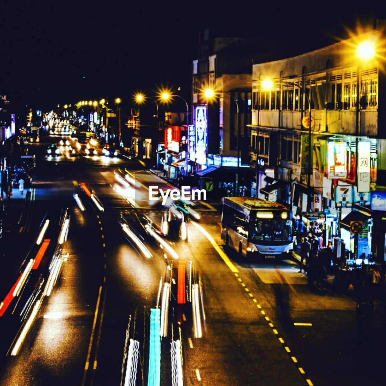 night, illuminated, blurred motion, motion, city, long exposure, transportation, architecture, building exterior, light trail, speed, built structure, street, road, city life, outdoors, street light, mode of transport, high street, no people, cityscape
