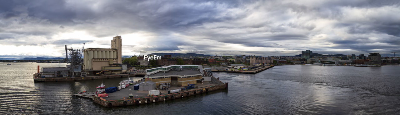 cloud - sky, water, architecture, built structure, transportation, sky, nautical vessel, building exterior, city, mode of transportation, river, waterfront, nature, cityscape, day, building, freight transportation, outdoors, passenger craft, cruise ship