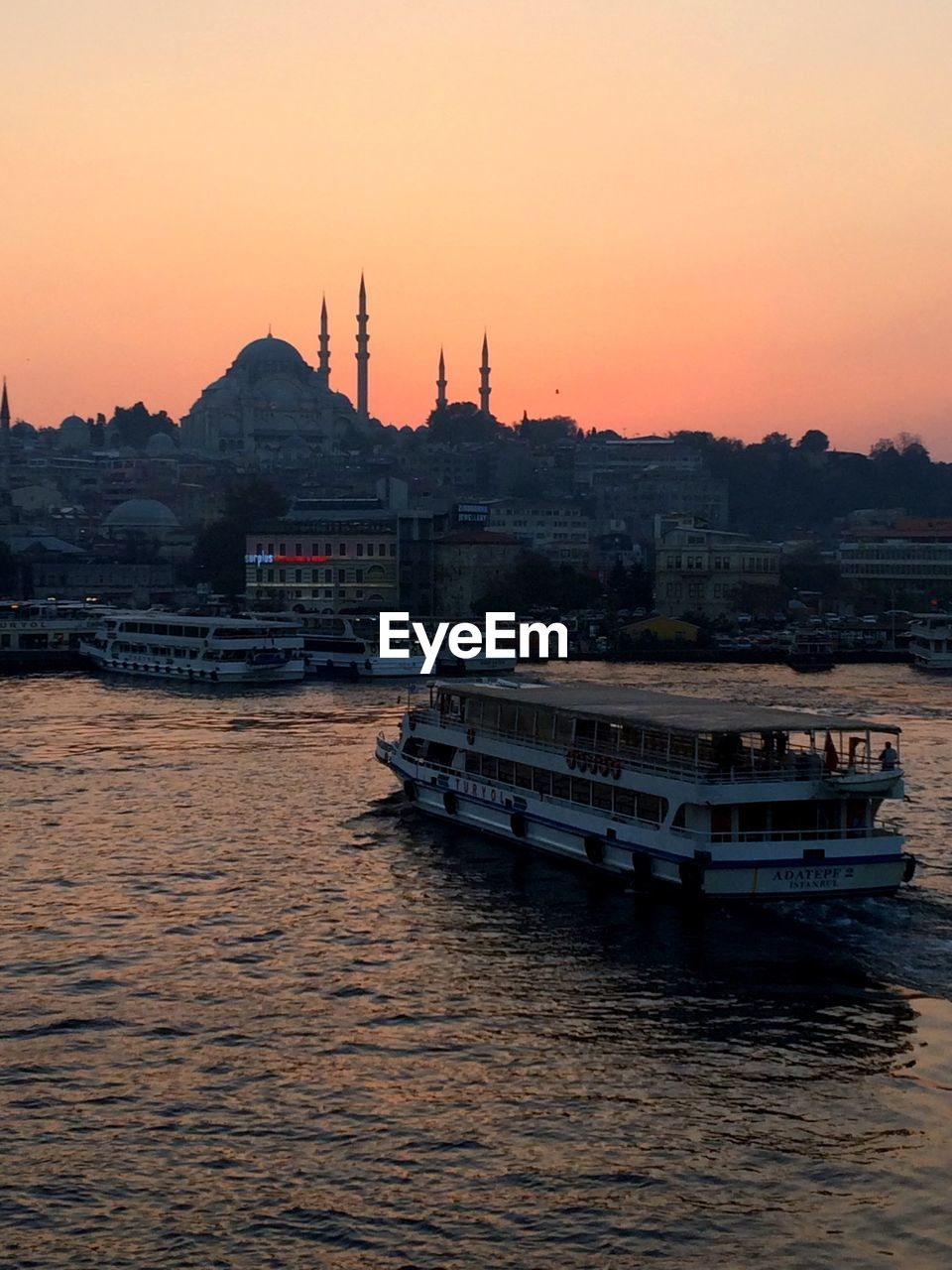 sunset, architecture, built structure, religion, transportation, building exterior, nautical vessel, water, orange color, waterfront, place of worship, travel destinations, mode of transport, spirituality, tourism, no people, travel, river, dome, outdoors, nature, sky, mountain, clear sky, city, day