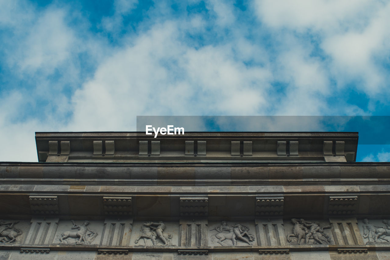 cloud - sky, low angle view, architecture, built structure, sky, building exterior, text, day, no people, script, communication, nature, non-western script, history, the past, outdoors, building, architectural column, pattern, western script