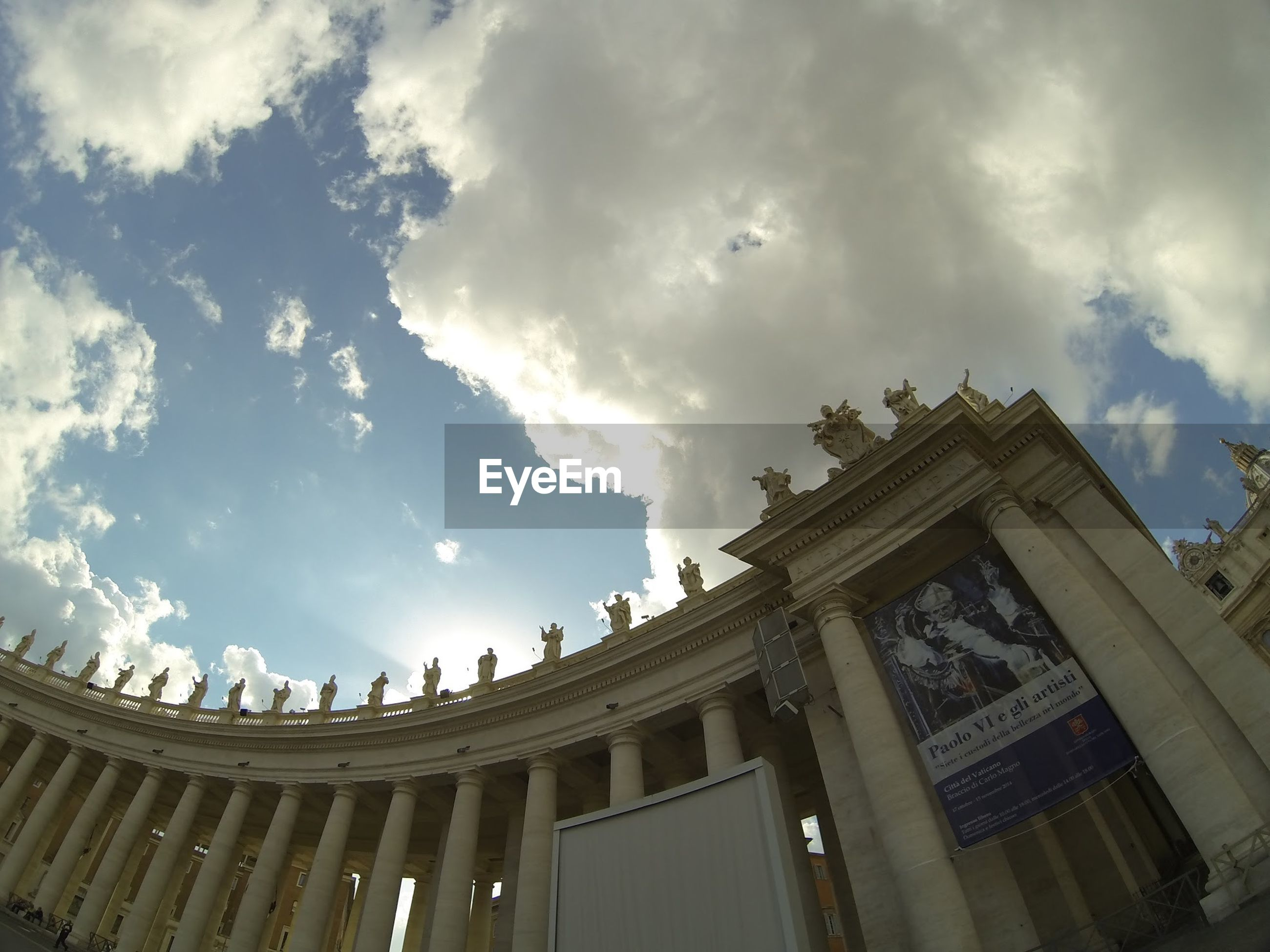 Low angle view of st peters basilica columns against sky in city