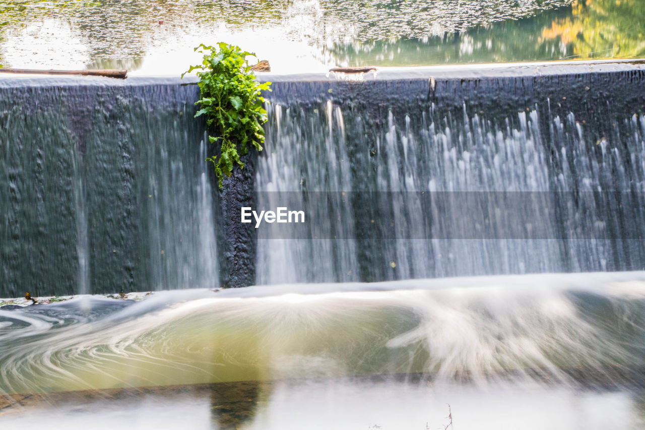 motion, water, waterfall, long exposure, flowing water, splashing, fountain, blurred motion, outdoors, spraying, no people, nature, day, running water, beauty in nature, tree, speed, scenics, close-up, freshness