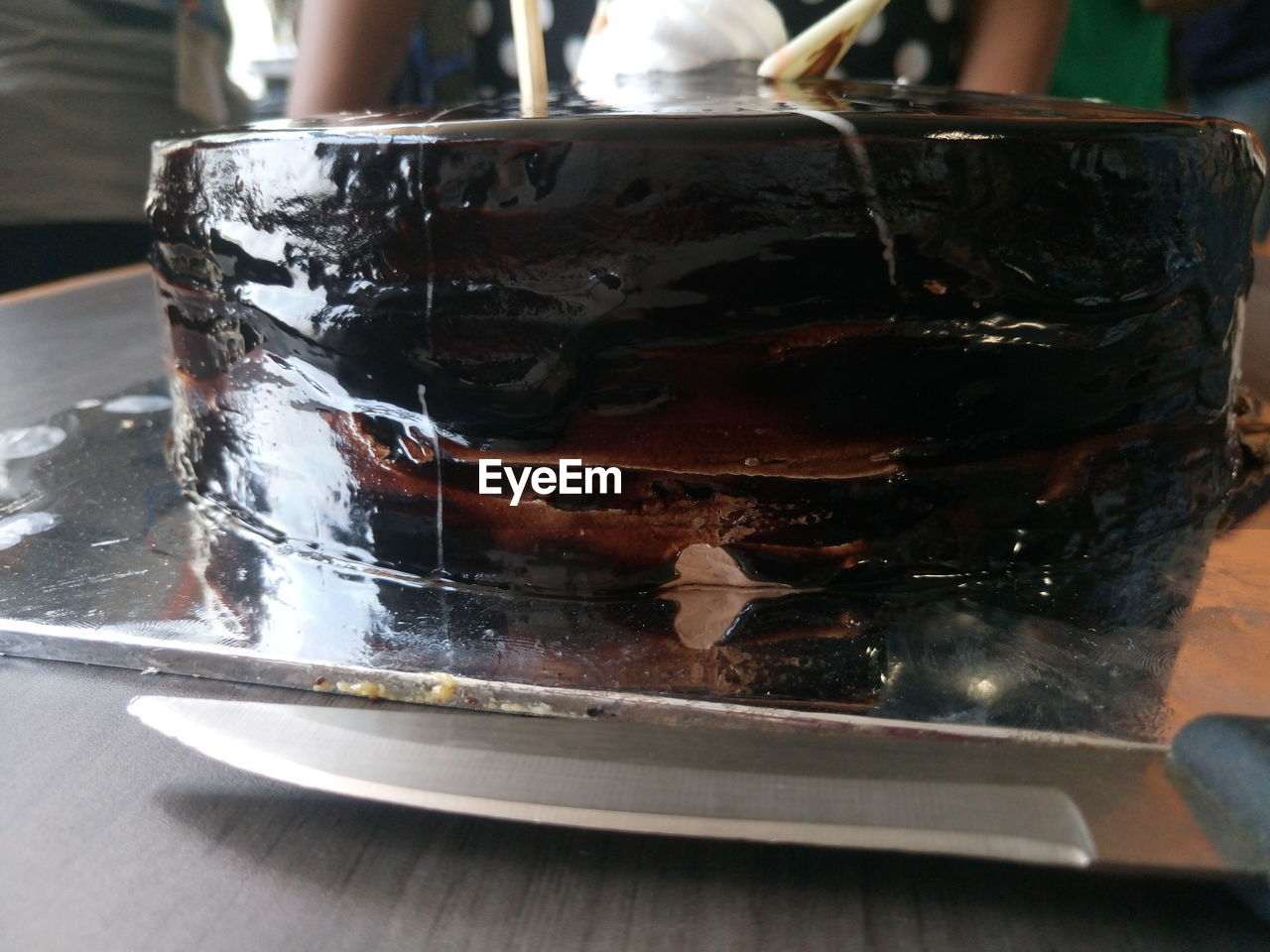 Close-up of chocolate cake with knife on table
