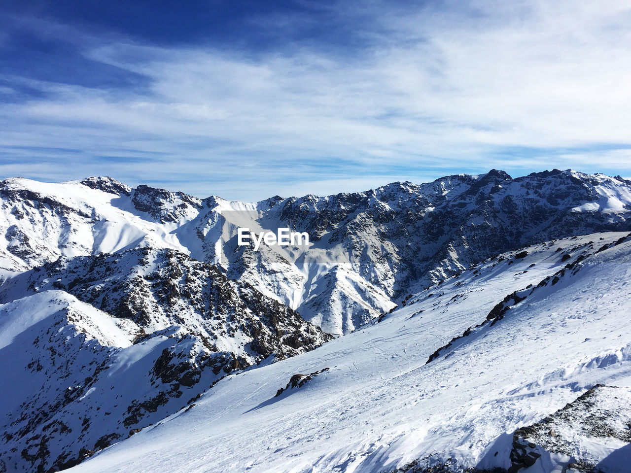 cold temperature, snow, winter, sky, cloud - sky, beauty in nature, scenics - nature, tranquil scene, mountain, tranquility, snowcapped mountain, white color, non-urban scene, mountain range, day, nature, environment, no people, landscape, extreme weather, mountain peak
