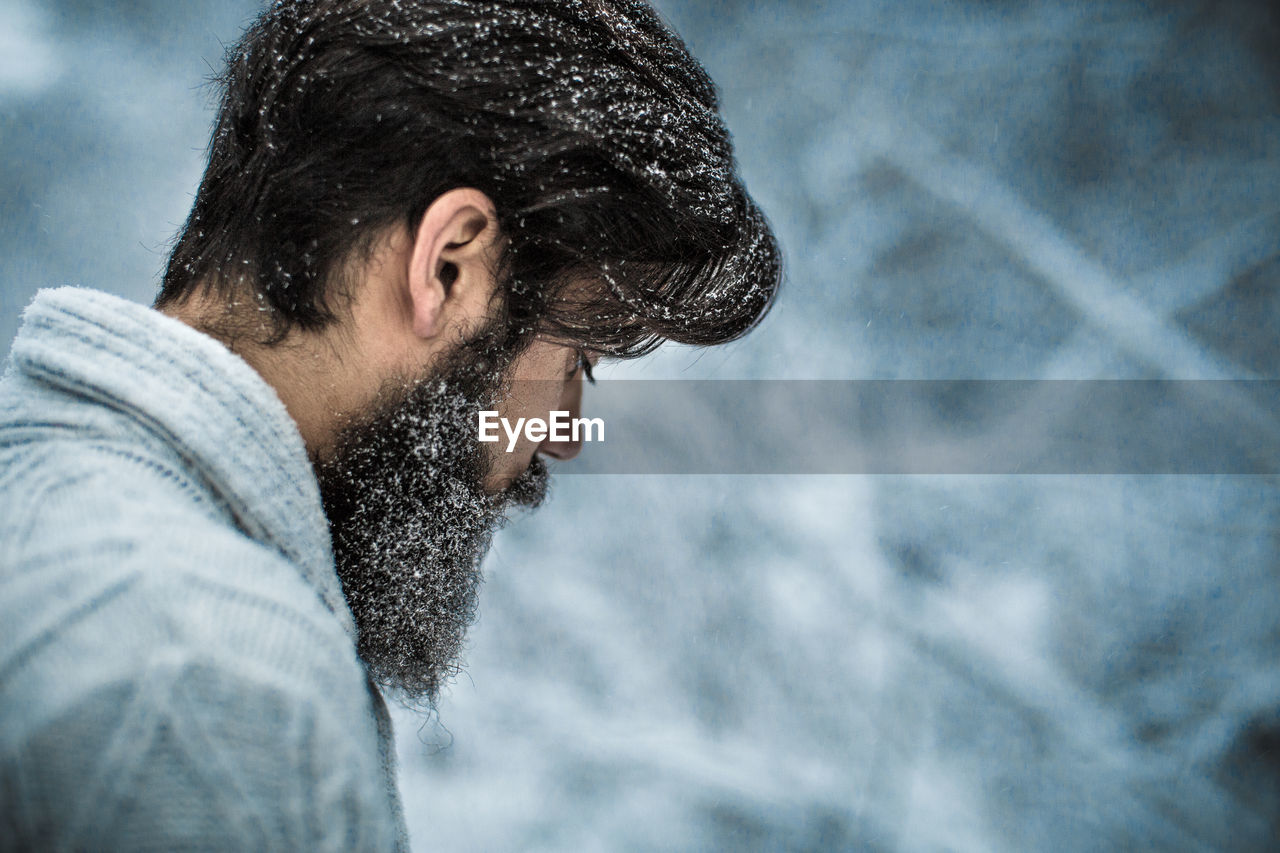 beard, facial hair, one person, young adult, young men, headshot, looking, men, portrait, cold temperature, focus on foreground, side view, winter, lifestyles, real people, leisure activity, casual clothing, day, outdoors, contemplation, warm clothing, hairstyle, profile view