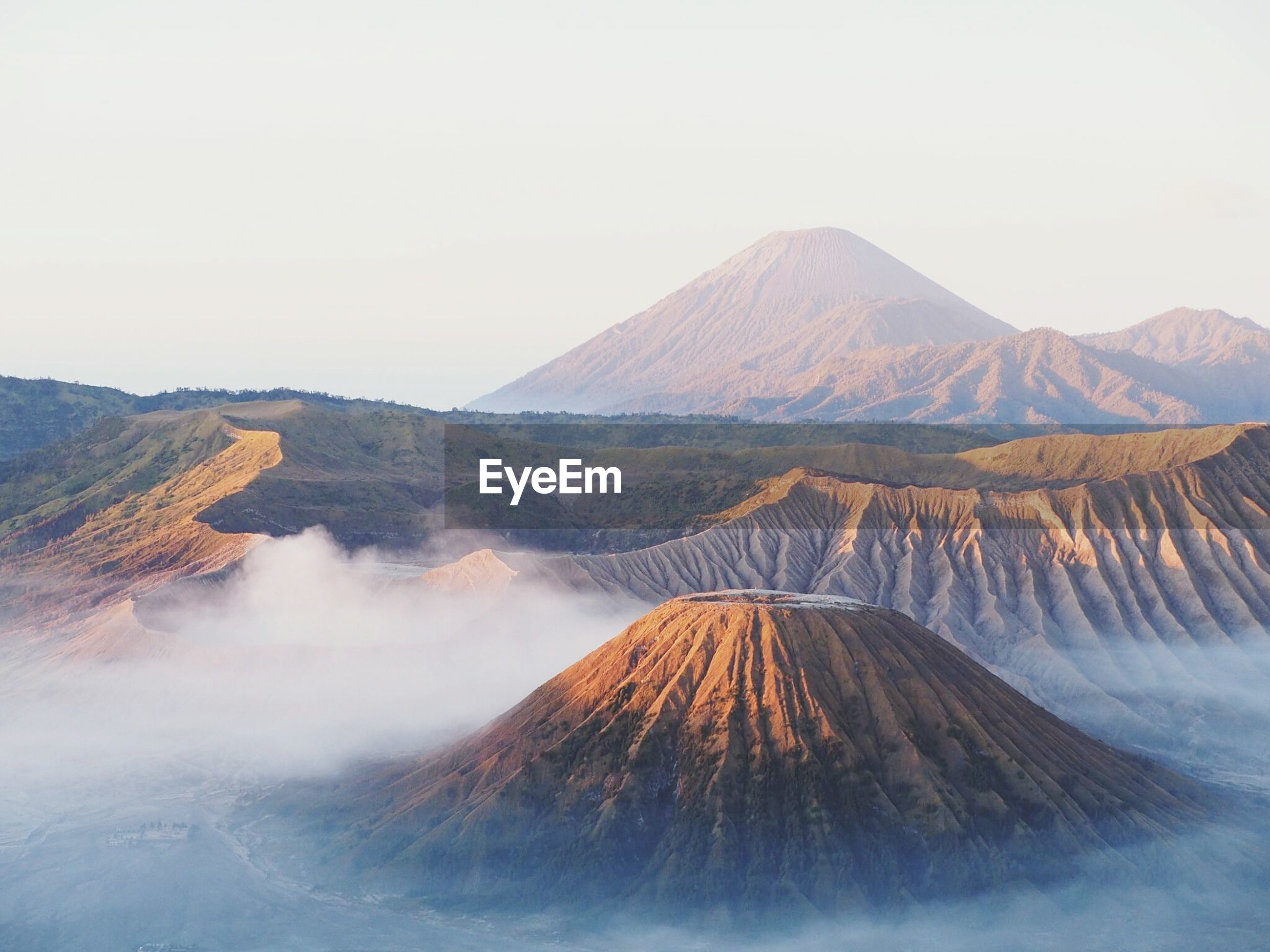 Volcanic crater and mountains against clear sky