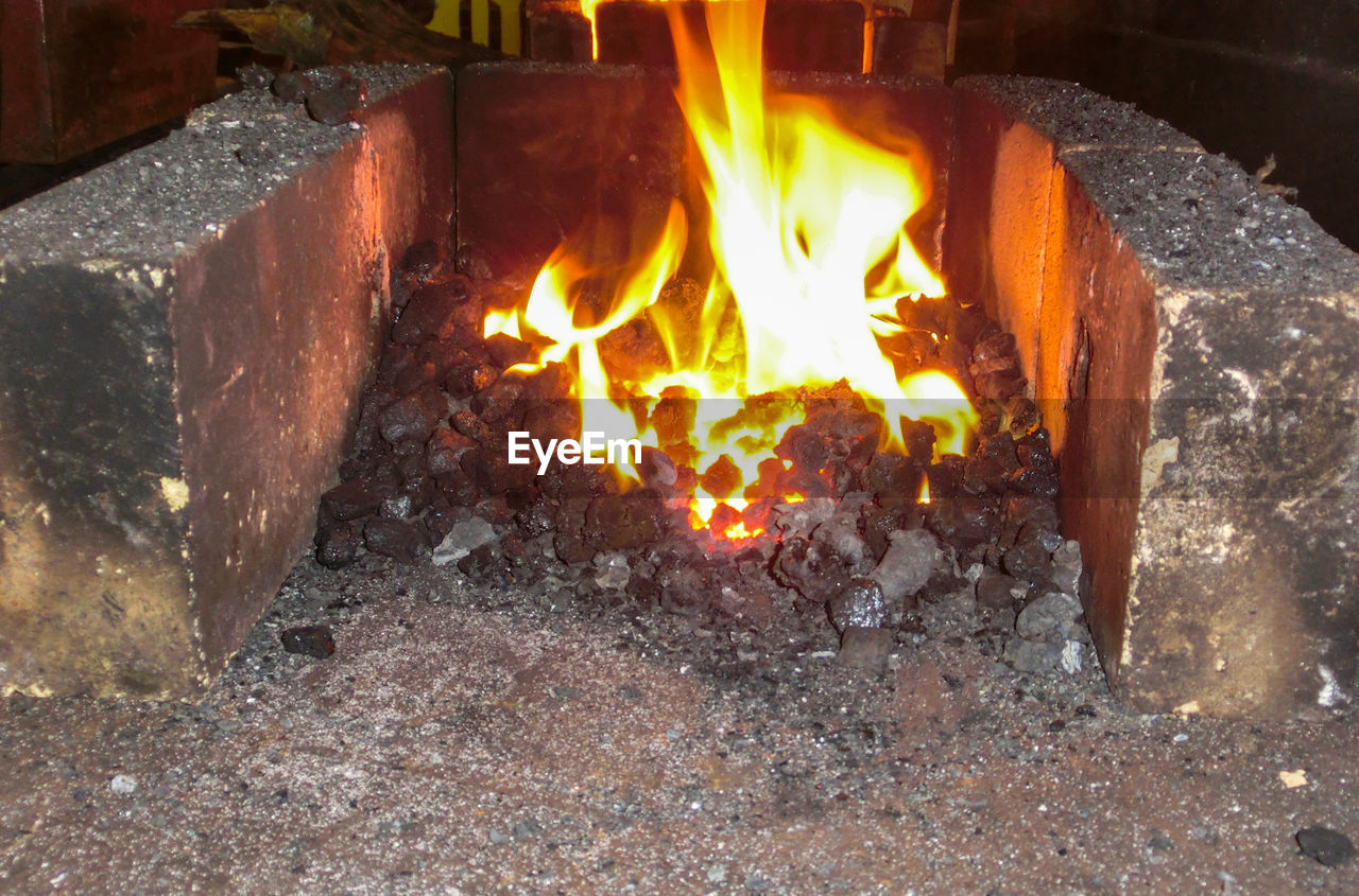 flame, burning, heat - temperature, wood - material, no people, outdoors, close-up, day
