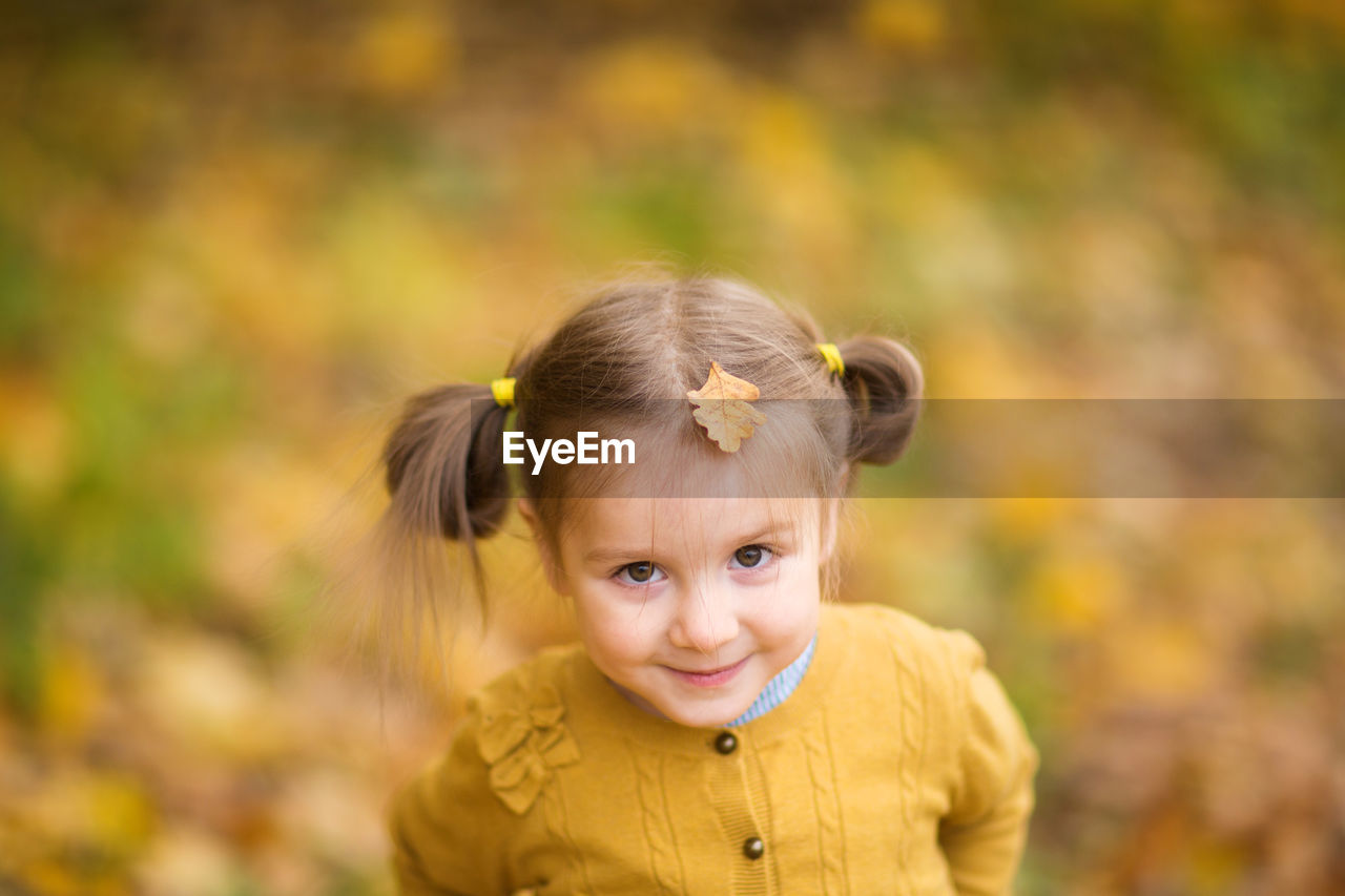 PORTRAIT OF CUTE GIRL WITH YELLOW EYES