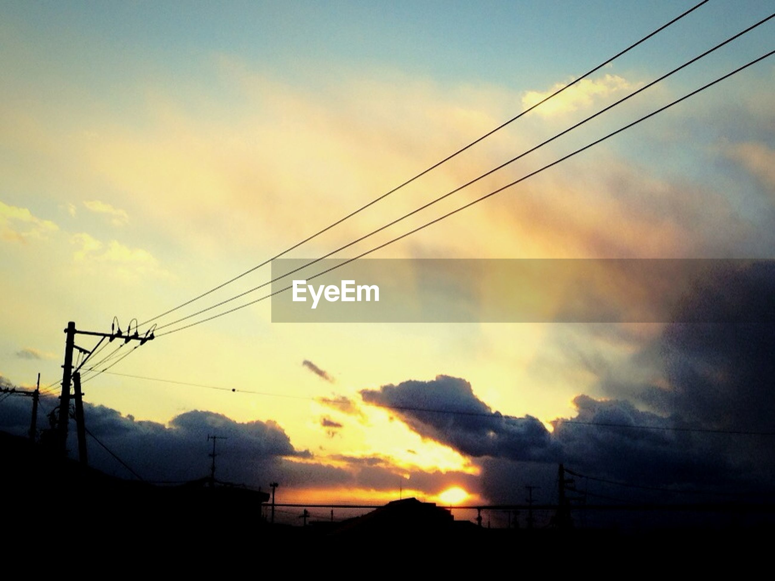 power line, electricity pylon, sunset, power supply, electricity, silhouette, sky, cable, fuel and power generation, connection, cloud - sky, low angle view, tranquility, beauty in nature, scenics, tranquil scene, power cable, cloud, technology, nature