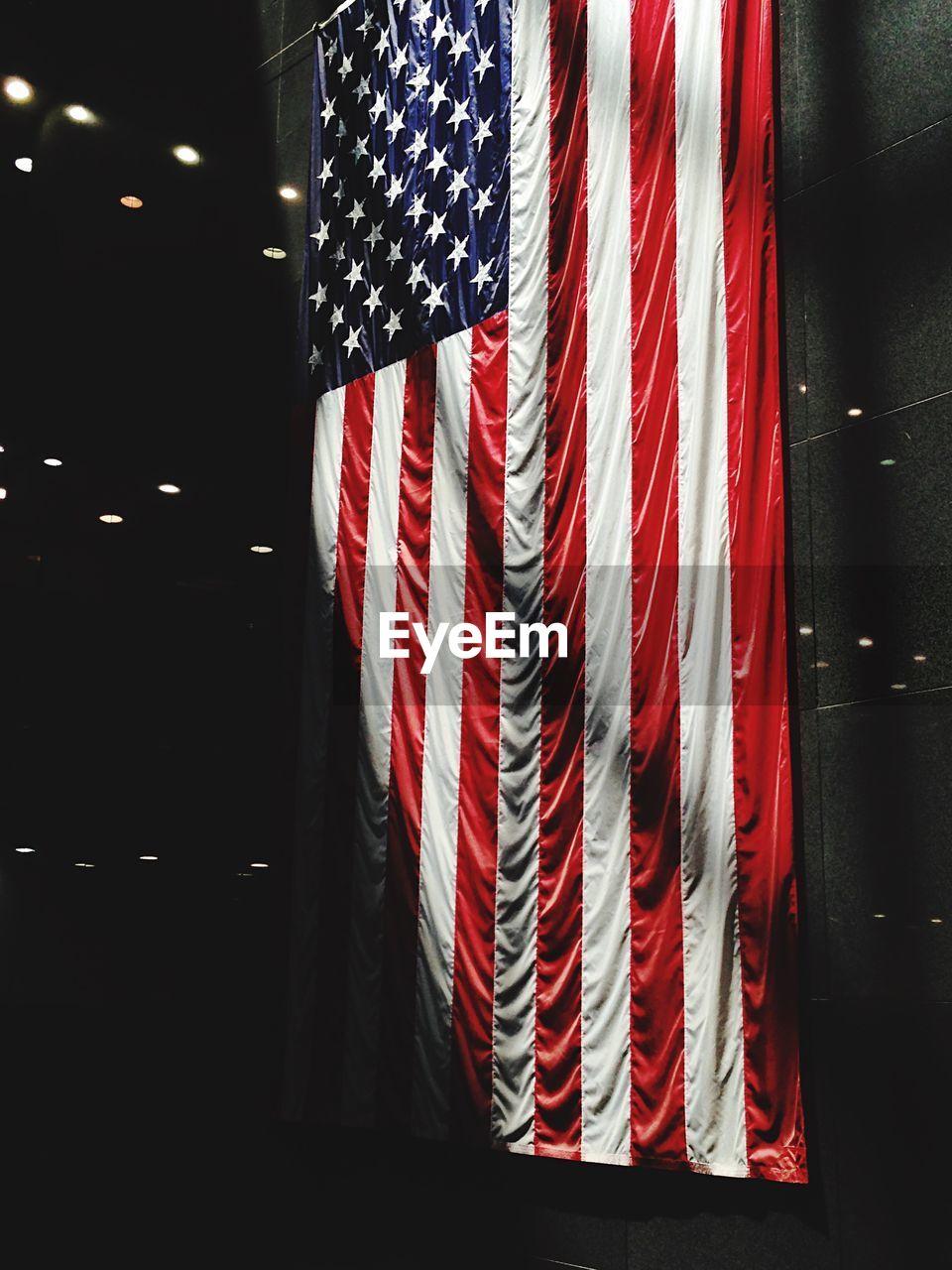 American Flag Hanging At Night