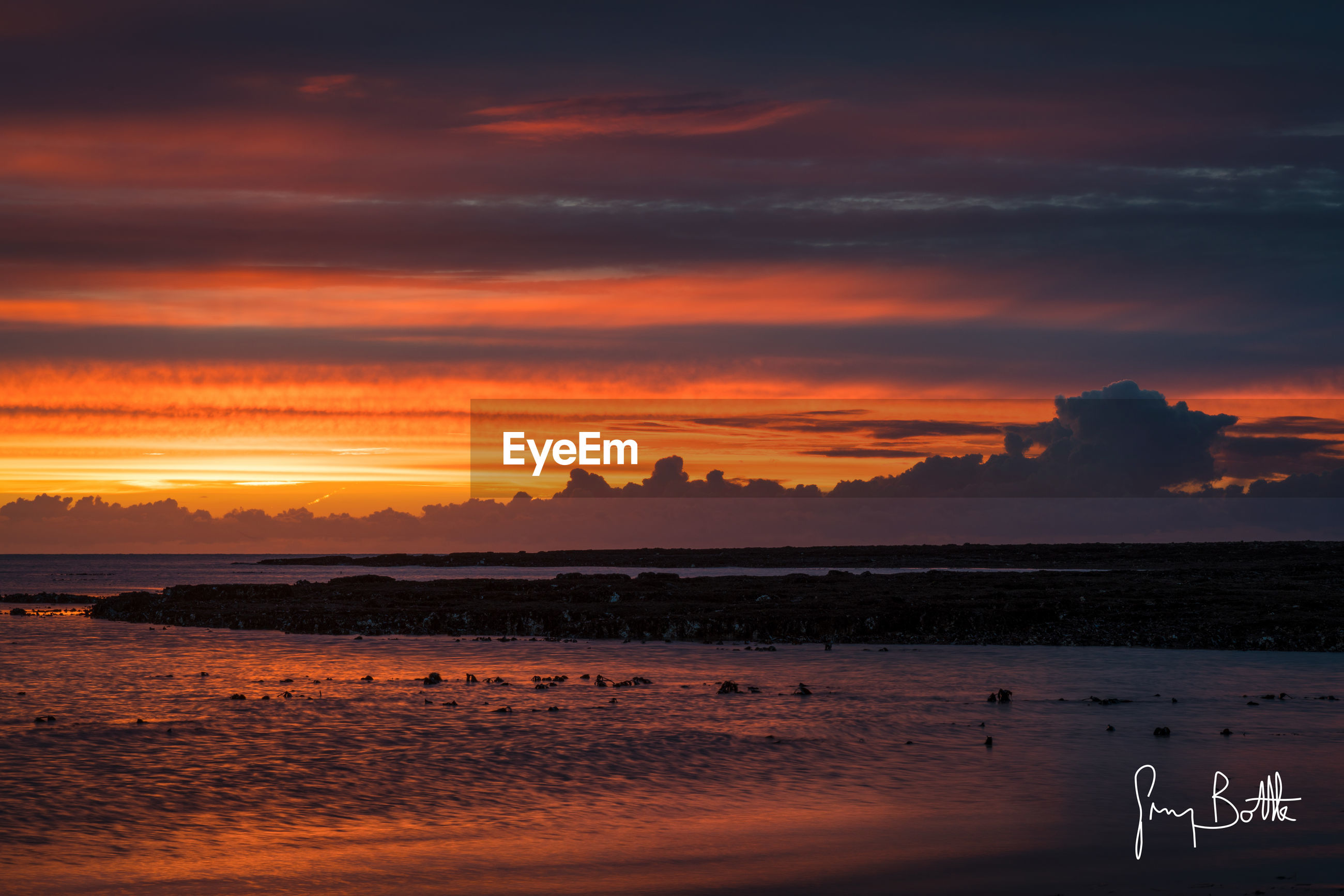 sunset, beauty in nature, reflection, sky, scenics, sea, water, nature, cloud - sky, dramatic sky, idyllic, outdoors, horizon over water, beach, no people, silhouette, romantic sky, tranquil scene, landscape, astronomy, day