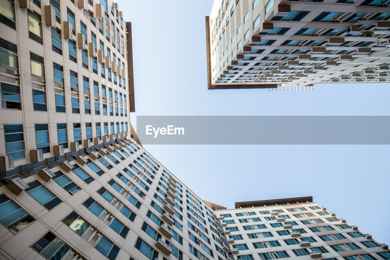 building exterior, built structure, architecture, building, sky, modern, city, tall - high, office building exterior, low angle view, clear sky, skyscraper, office, nature, tower, no people, day, window, outdoors, residential district, apartment, directly below, financial district