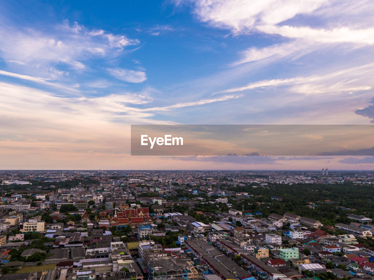 architecture, sky, building exterior, cityscape, built structure, crowded, city, cloud - sky, sunset, residential building, town, outdoors, community, sea, residential, nature, day