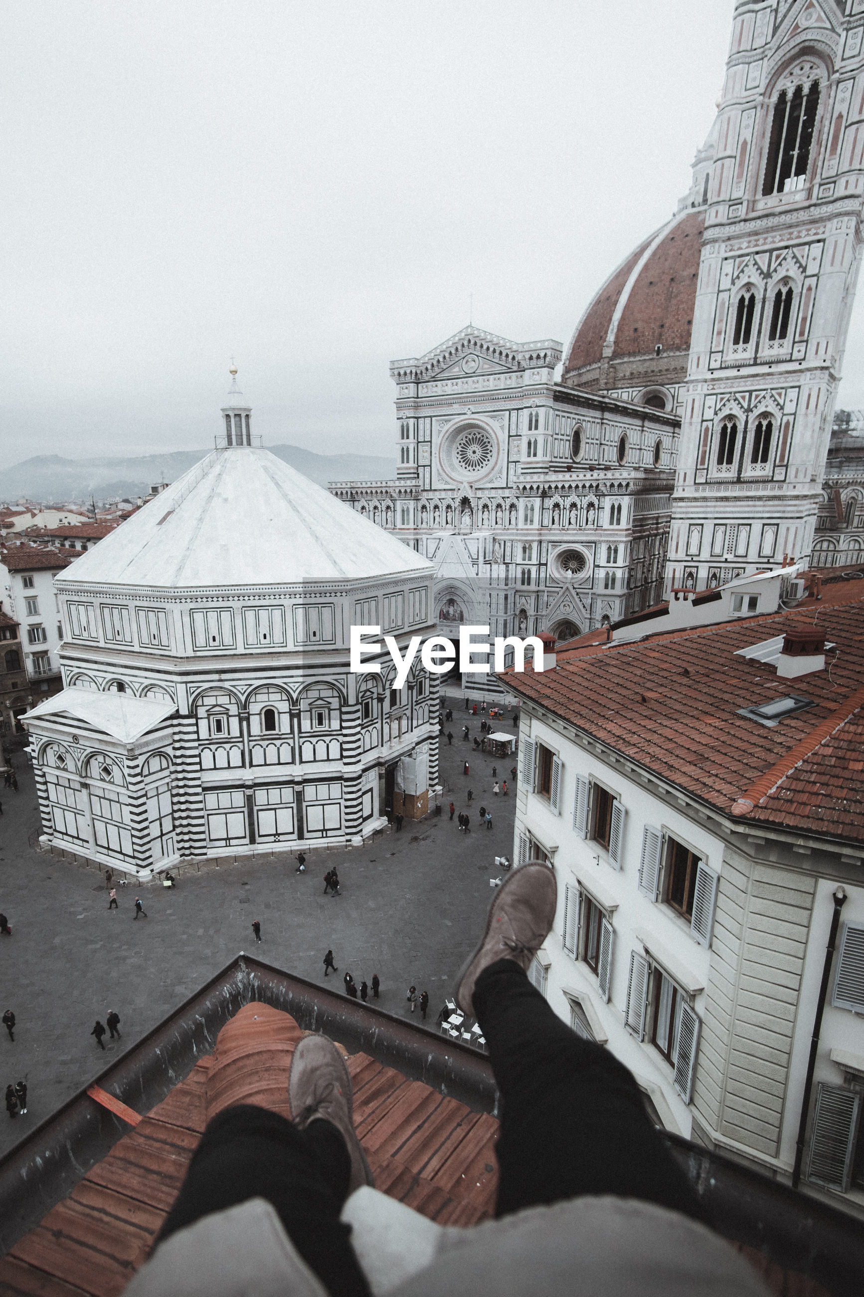 Low section of man on terrace against florence cathedral