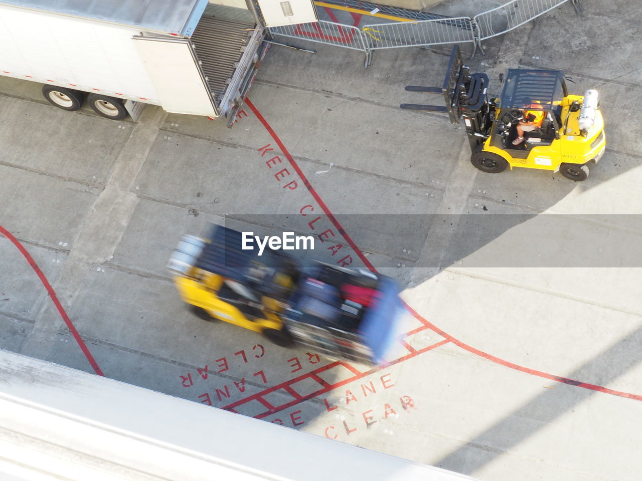 Blurred motion of forklifts in dock
