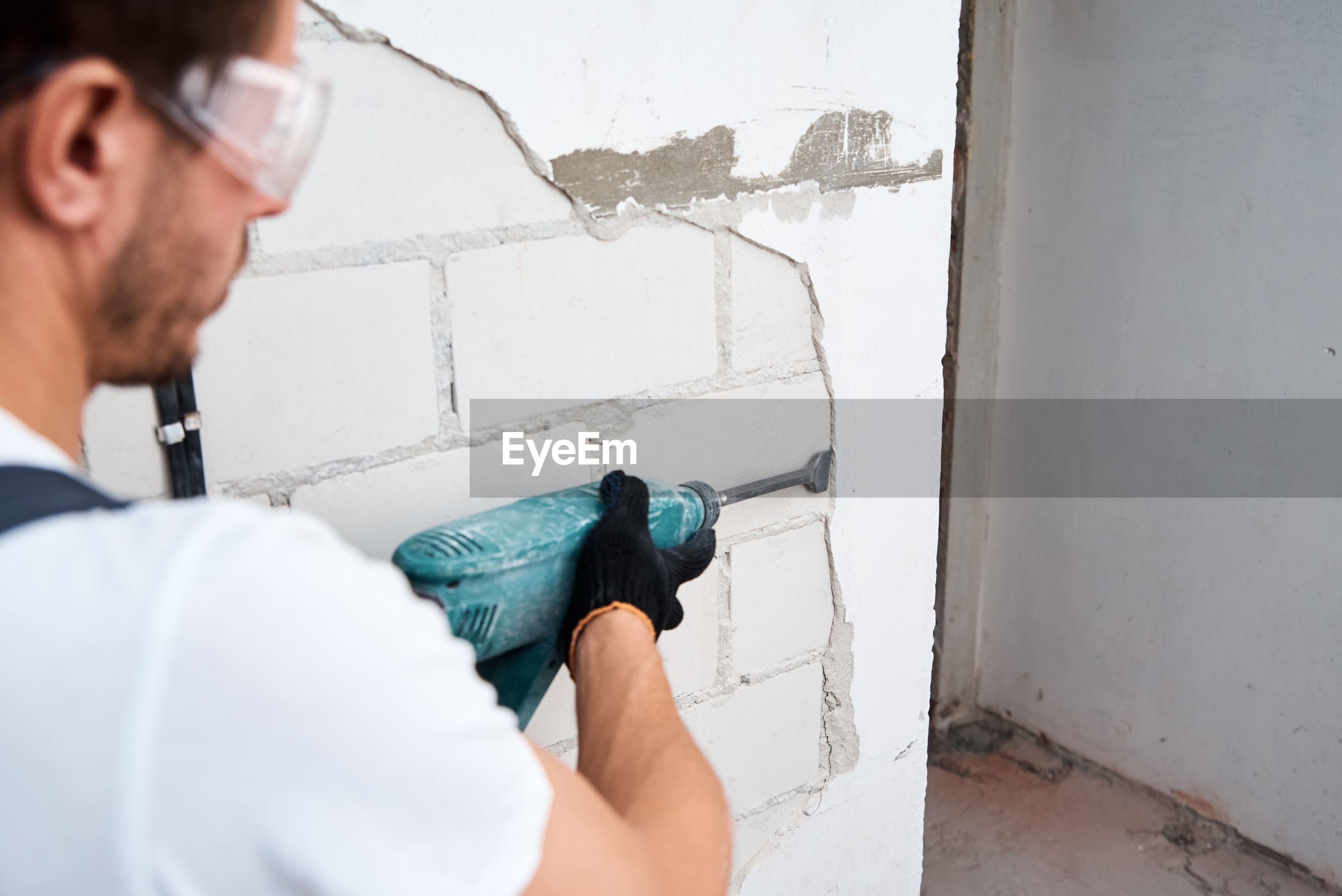 Portrait of man working on wall