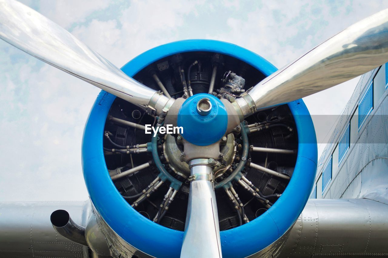 Close-Up Of Airplane Propeller Against Blue Sky
