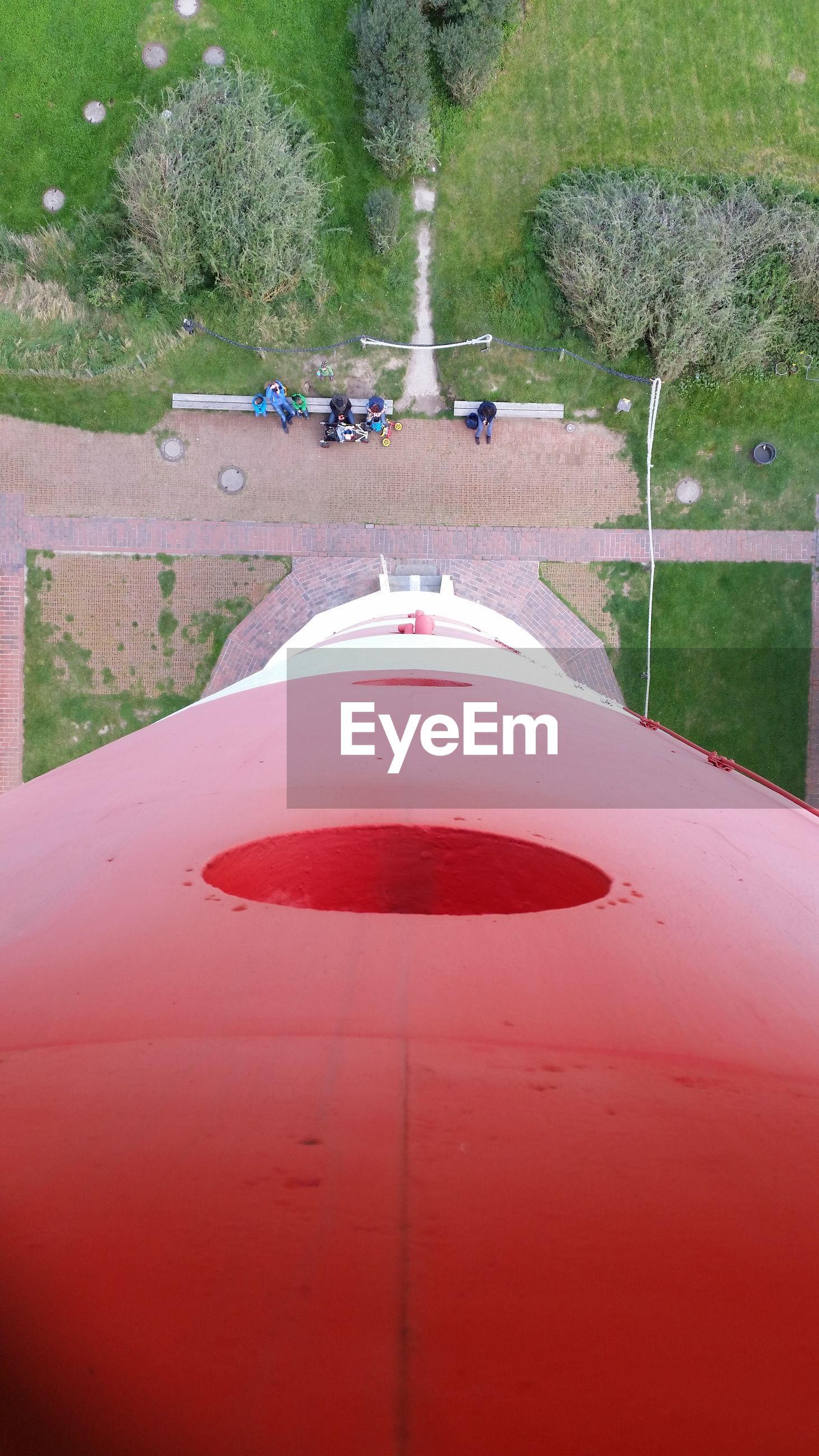 Directly above shot of people by red structure