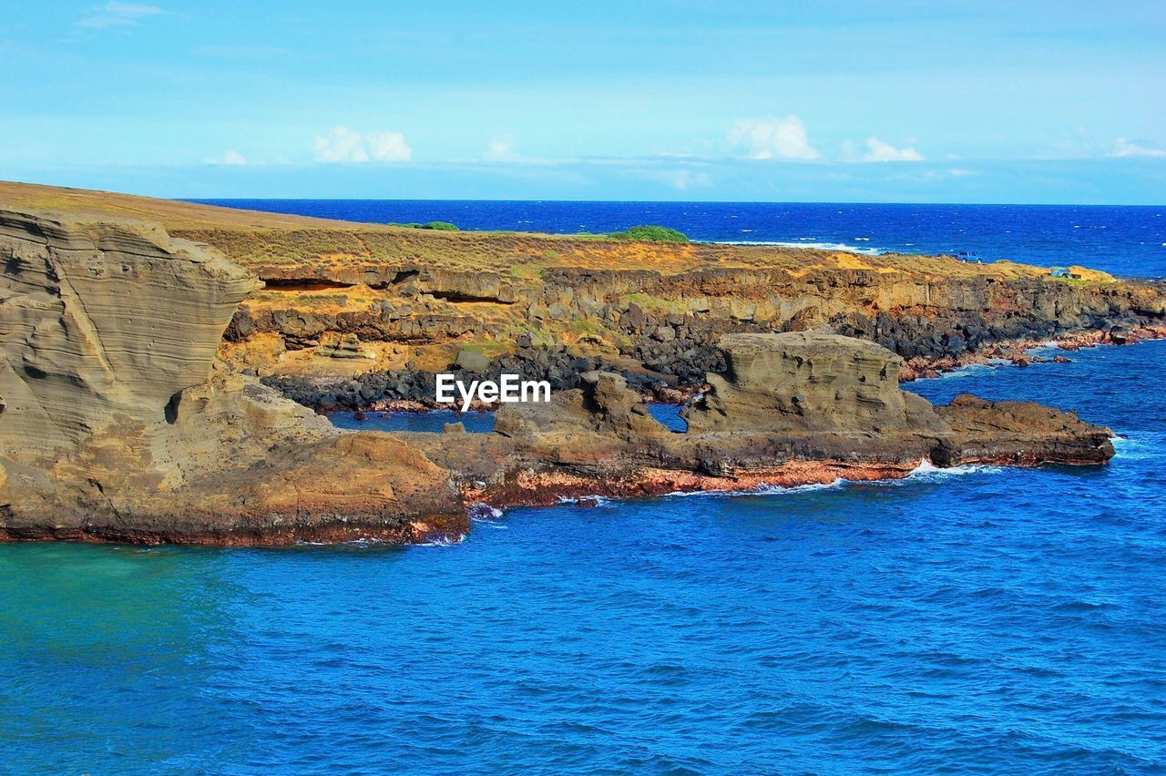 sea, rock - object, scenics, rock formation, water, nature, beauty in nature, sky, tranquil scene, tranquility, blue, day, waterfront, outdoors, no people, horizon over water, cliff, landscape
